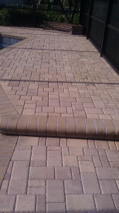 Faded thin pavers on pool deck in Northdale, Tampa