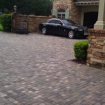 Paver parking area at Belleair home after cleaning and sealing